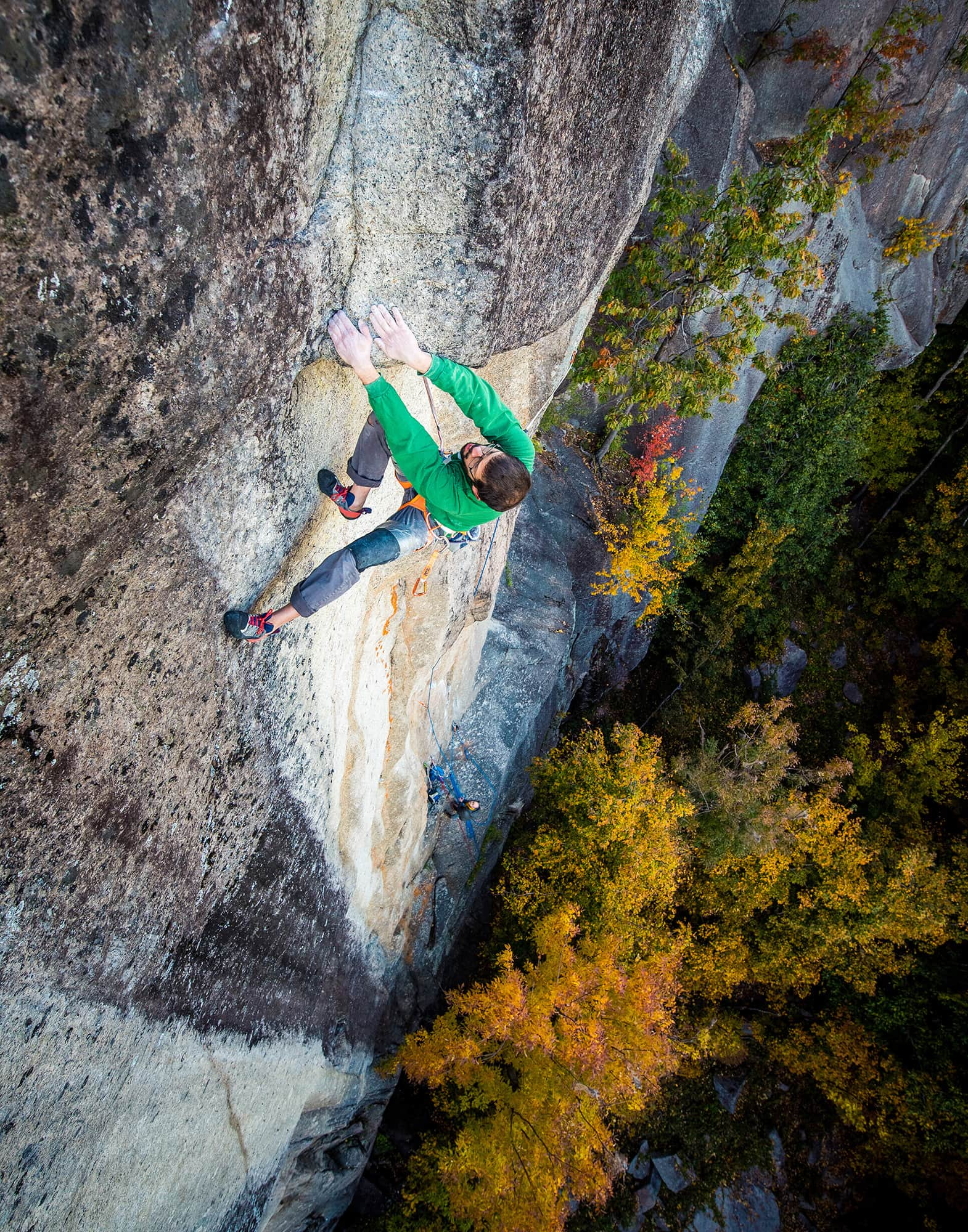"""Jay below the mantel crux  on pitch two (5.14a). """"Pitch one is really tech, with tons of V4 - V6 moves,"""" he says. """"You get to wear kneepads on both knees on Cathedral.... So, that's fun."""" Photo: Brent Doscher"""